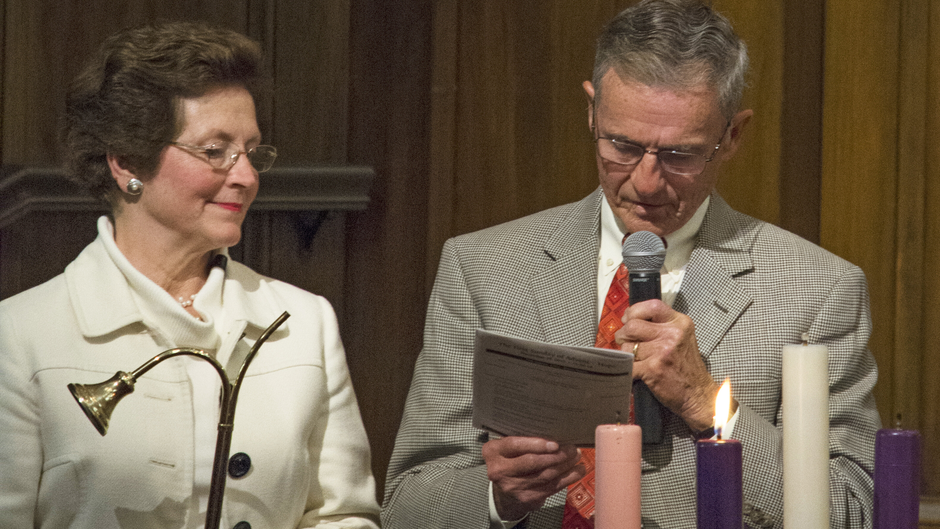 Bob and Sydnor lighting the Advent candle at First Baptist